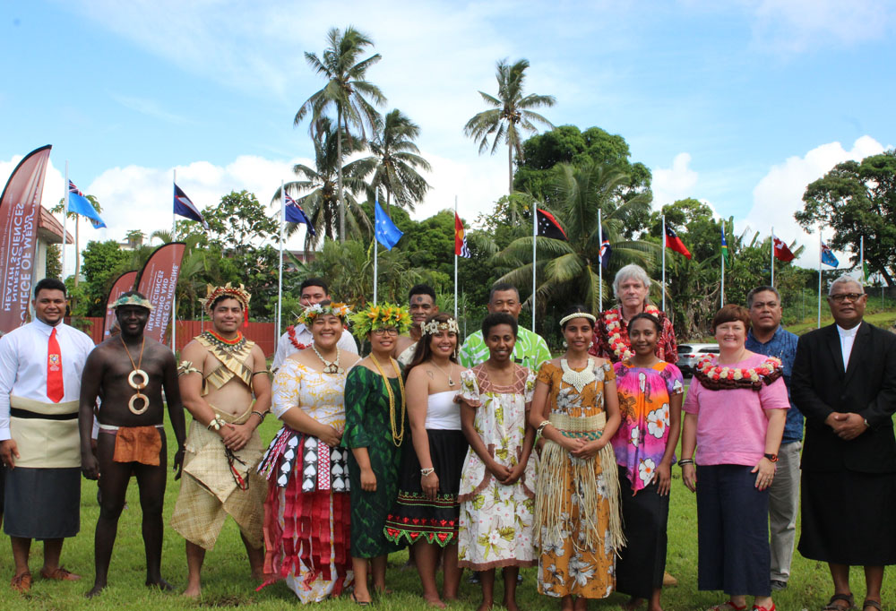 FNU Vice-Chancellor Professor Nigel Healey with CMNHS Dean, Dr William May, invited guests, senior staff and flag bearers