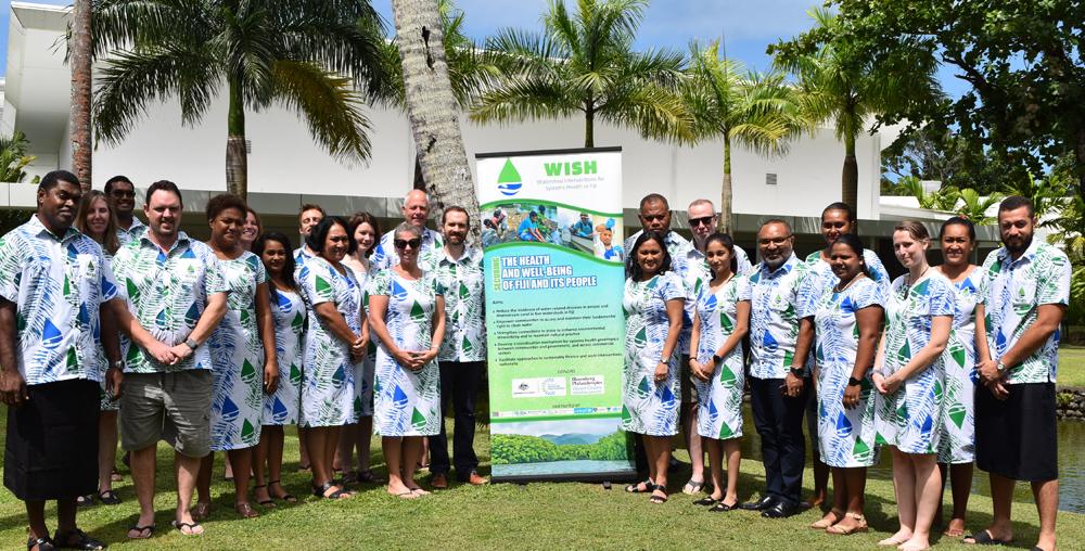 Dr Donald Wilson (standing front-3rd right) with participants of the WISH mid-term review workshop.