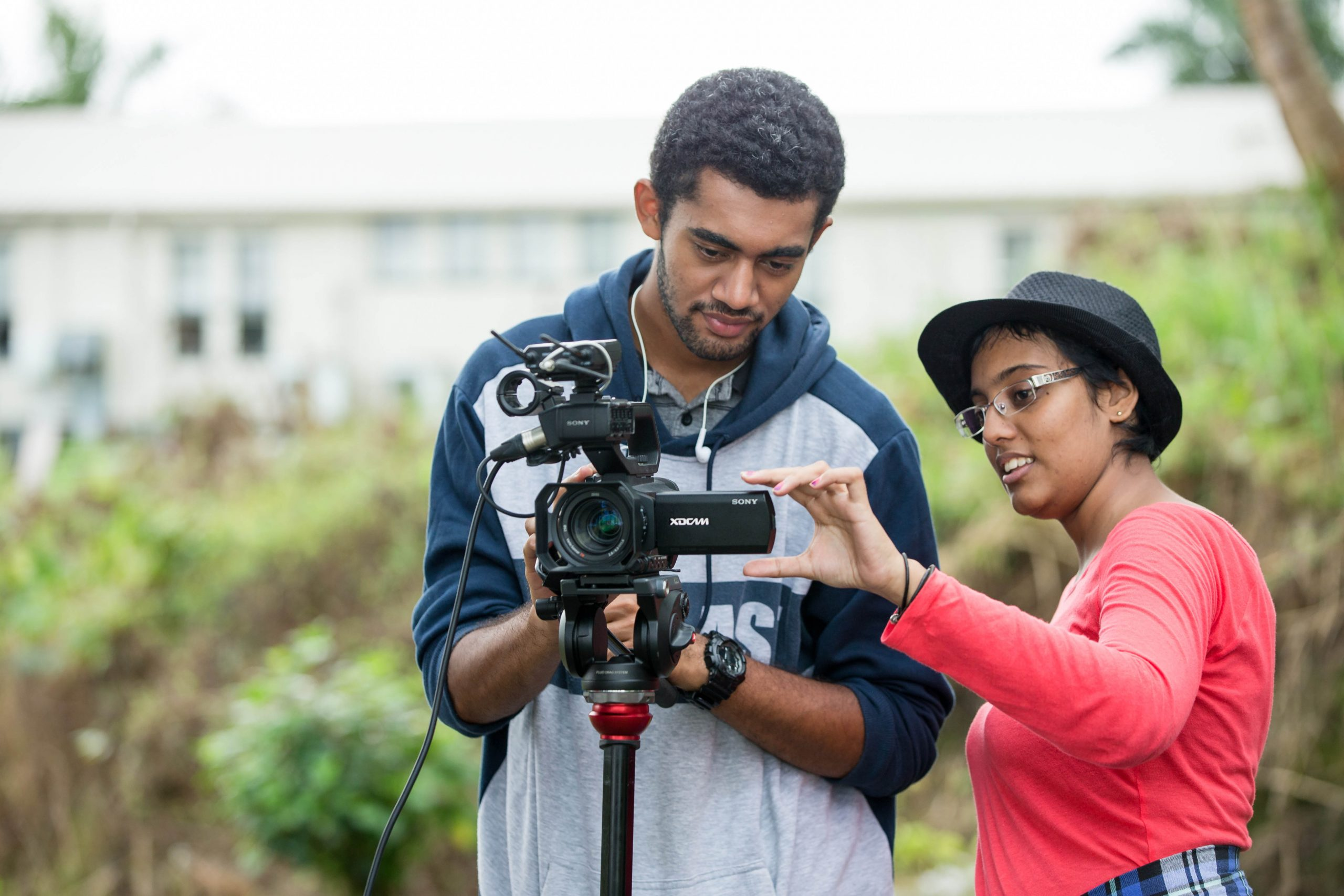 Sarah Robertson (right) tests the camera with a colleague during their practical session.